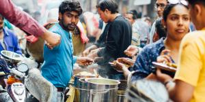 Busy street foood vendor in Delhi, India