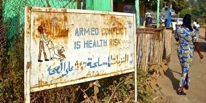 Road sign in Juba - Armed conflict is health risk