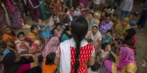 Health worker Durgesh addresses a meeting on malnutrition in  Jahangir Puri, New Delhi, India
